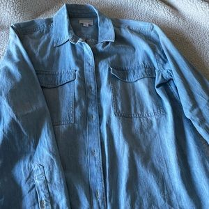 Light blue denim button up shirt.